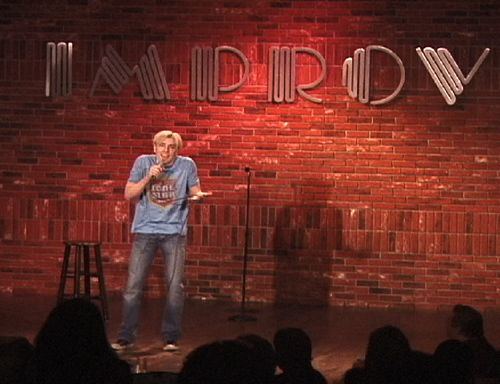 Scotch Wichmann on stage at the Improv