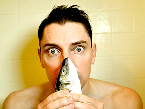 Scotch Wichmann sniffing a branzino in the shower